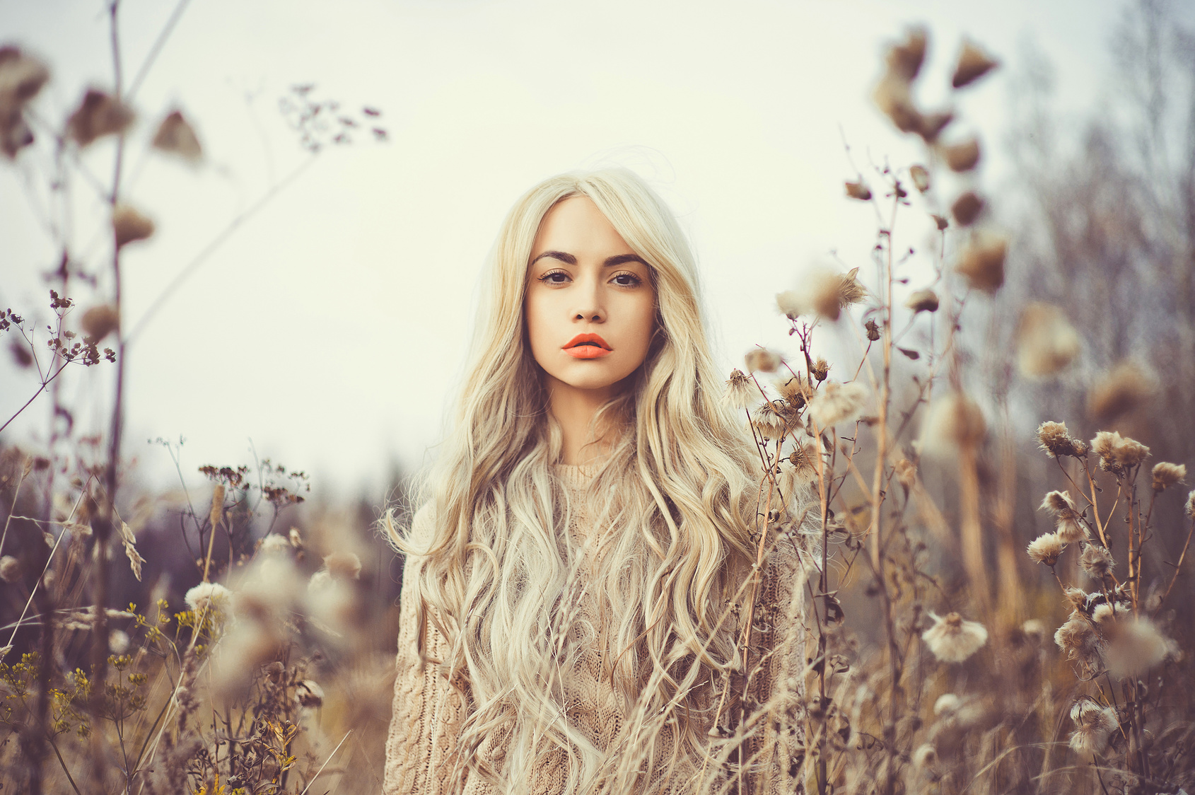 Beautiful lady in autumn landscape