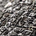 Letterpress background, close up of many old, random metal lette